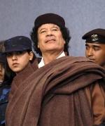 полковник Муамар Кадафи.